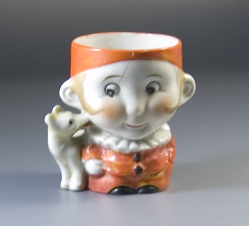 1940s/50s Egg Cup formed as a boy with dog licking hs face